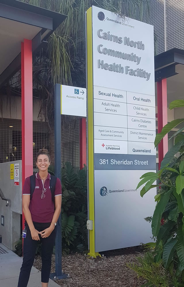 Studnet in front of health facility